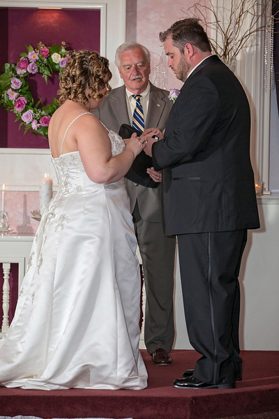 Putting the ring on the bride.jpg