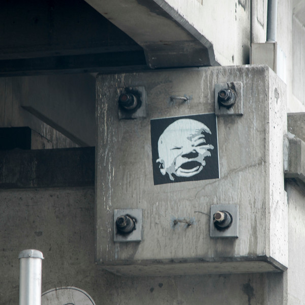 Poster of a face on a concrete block, Seattle, Washington State, USA