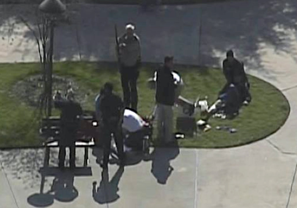 . This frame grab provided by KPRC Houston shows the scene at Lone Star College Tuesday, Jan. 22, 2013 as police and emergency personnel work.  A shooting at the Texas community college campus wounded at least two people Tuesday and sent students fleeing for safety officials said.  (AP Photo/Courtesy KPRC TV)