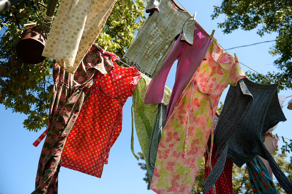 . The Newman family hangout their laundry to dry at their farm in Trenton, Mo., Tuesday, September 24, 2013. Many of the dresses the girls wear are home made. (Photo By RJ Sangosti/The Denver Post)