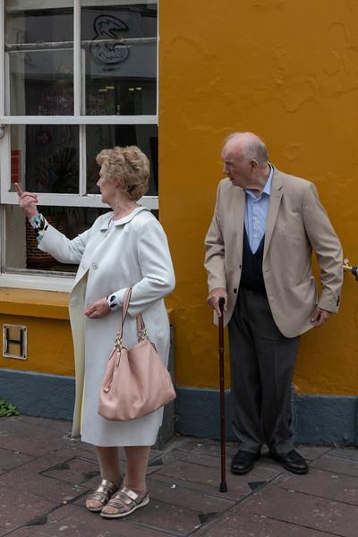 Senior couple on the sidewalk, City of Cork, County Cork, Ireland