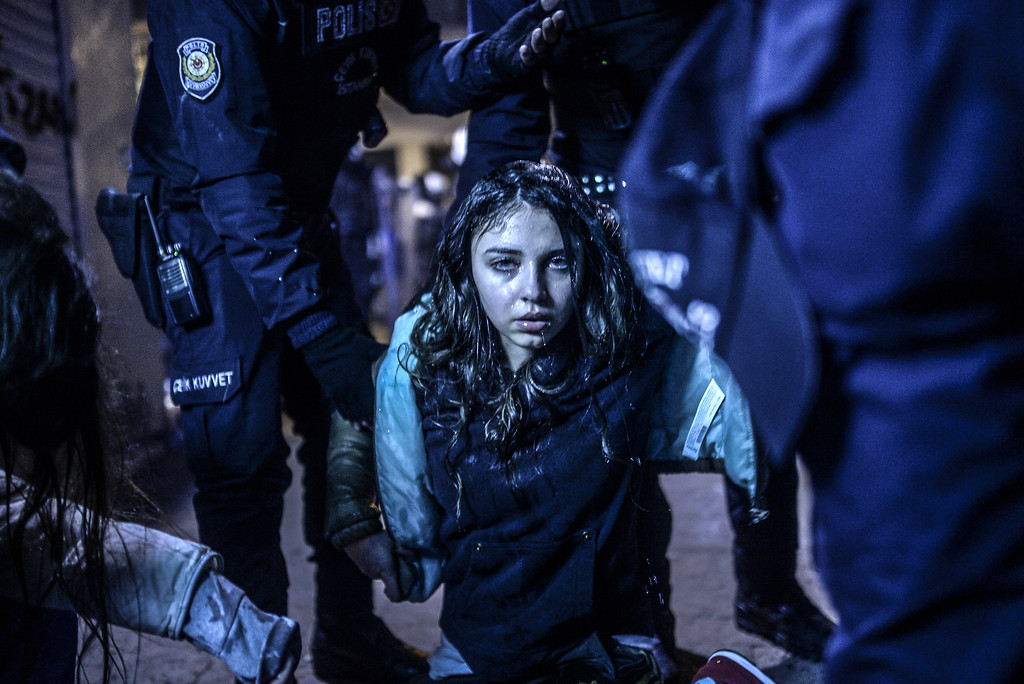 . A young girl is pictured after she was  wounded during clashes between riot-police and prostestors after the funeral of Berkin Elvan, the 15-year-old boy who died from injuries suffered during last year\'s anti-government protests, in Istanbul on March 12, 2014. Riot police fired tear gas and water cannon at protestors in the capital Ankara, while in Istbanbul, crowds shouting anti-government slogans lit a huge fire as they made their way to a cemetery for the burial of Berkin Elvan. AFP PHOTO/BULENT  KILIC/AFP/Getty Images