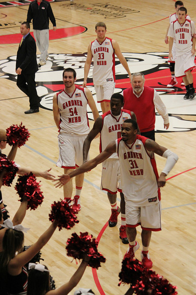 Cheerleaders and fans congratulate the team on their victory over Alice Lloyd, 87-57