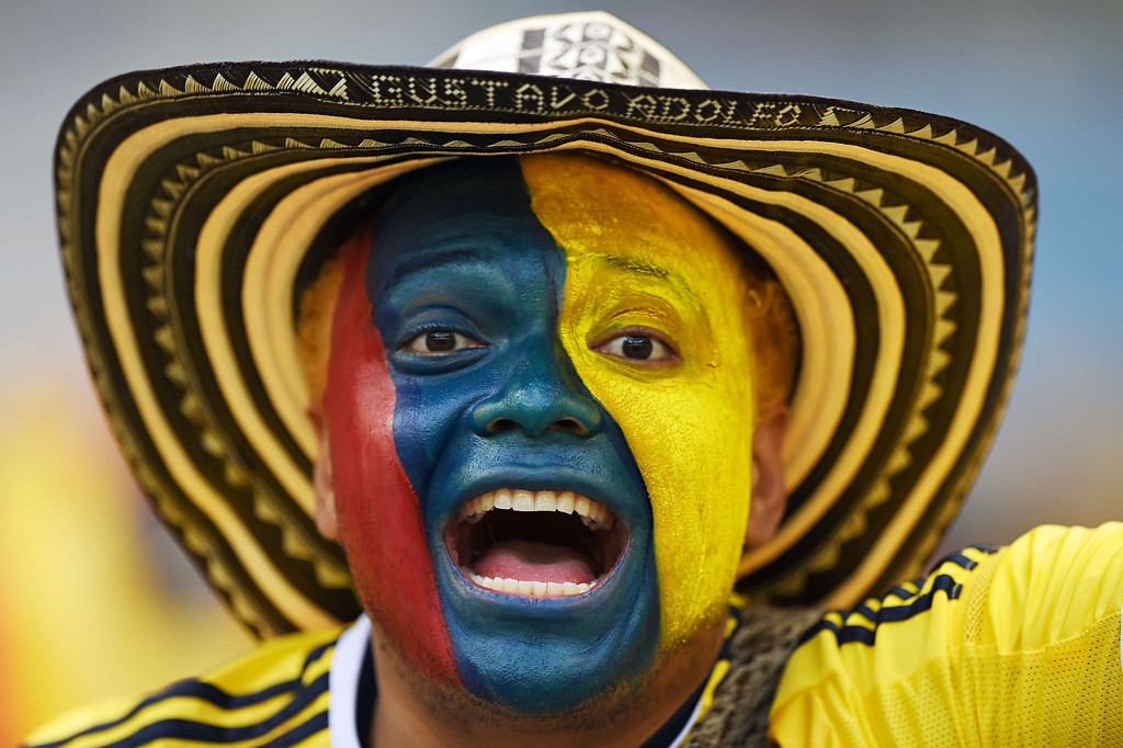 . A Colombian supporter waits for the start of a Group C football match between Colombia and Greece at the Mineirao Arena in Belo Horizonte during the 2014 FIFA World Cup on June 14, 2014.   AFP PHOTO / EITAN ABRAMOVICHEITAN