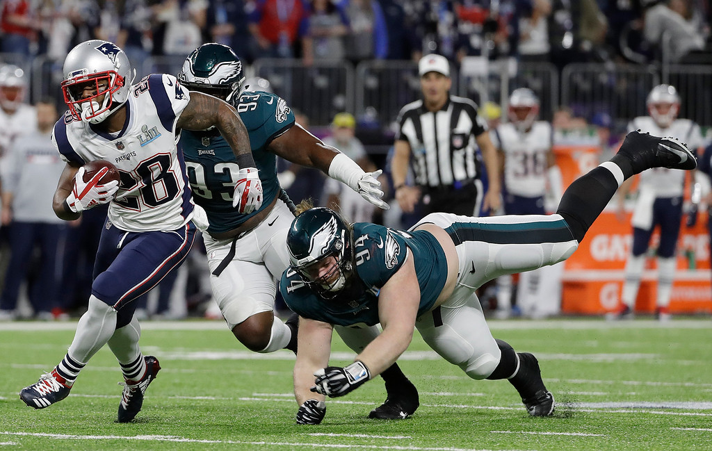 . New England Patriots\' James White, left, runs during the first half of the NFL Super Bowl 52 football game against the Philadelphia Eagles Sunday, Feb. 4, 2018, in Minneapolis. (AP Photo/Matt Slocum)
