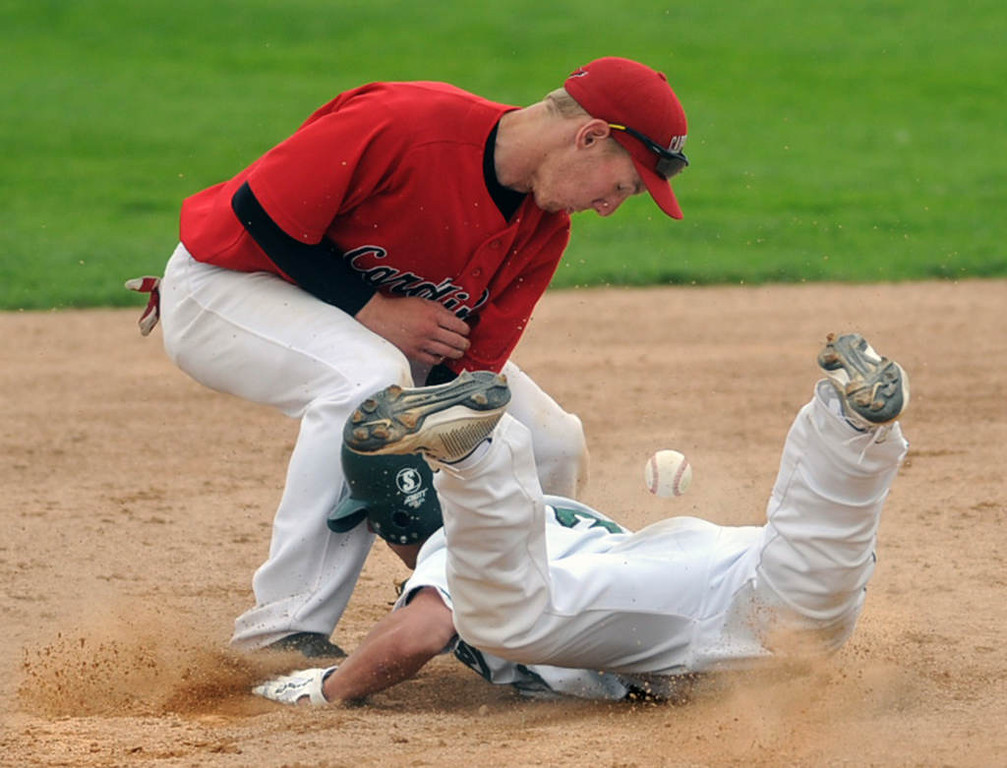 . Mounds View\'s Joe Janey dives safely back to second base on a pickoff attempt by Coon Rapids\' Jace Hegg in the sixth inning. (Pioneer Press: Chris Polydoroff)