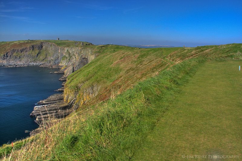 The terrifying 12th at Old Head - most intimidating golf hole anywhere. 575-yard par 5 down the narrow spine of the peninsula, with a strong wind blowing your ball left over the 500-foot cliffs.