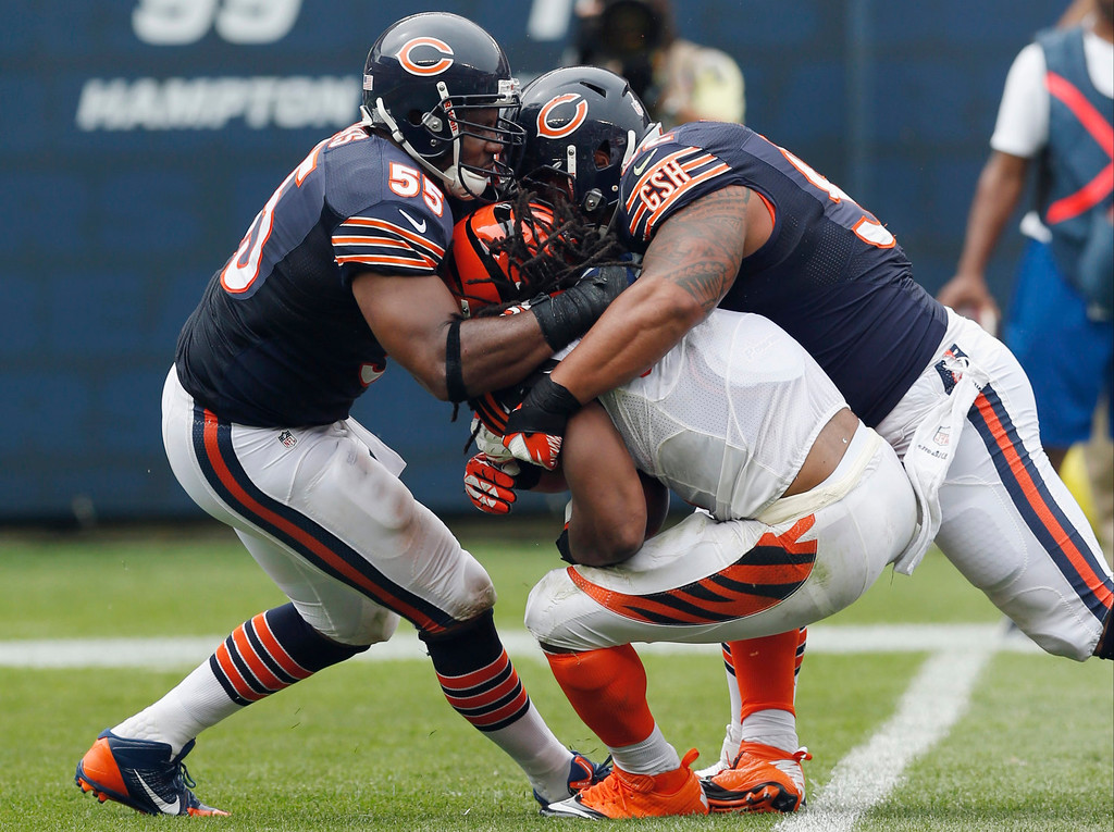 . Cincinnati Bengals running back BenJarvus Green-Ellis is tackled by Chicago Bears linebacker Lance Briggs (55) and defensive tackle Stephen Paea, right, during the first half of an NFL football game, Sunday, Sept. 8, 2013, in Chicago. (AP Photo/Charles Rex Arbogast)