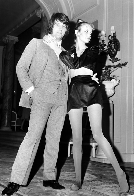 ". British model Leslie Horby, better known as ""Twiggy"", with her arms around friend and director Justine De Villeneuve, at the Ritz Hotel, in London, on Jan. 20, 1969. Twiggy was launching a new range of tights. (AP Photo)"