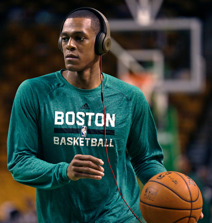 """. Boston Celtics guard Rajon Rondo wears headphones as he works out during a practice before an NBA basketball game against the Los Angeles Lakers, in Boston, Friday, Jan. 17, 2014. Celtics head coach Brad Stevens and general manager Danny Ainge both said Rondo would return for the game \""""barring any setbacks.\"""" (AP Photo/Charles Krupa)"""