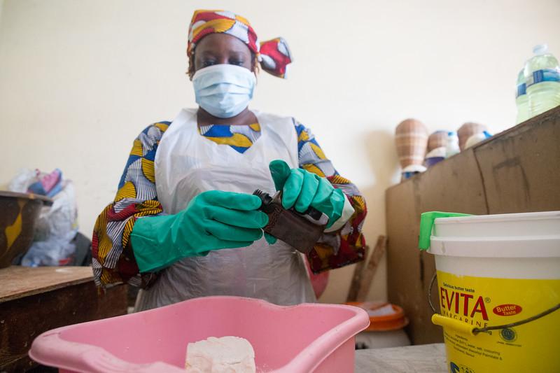 Monrovia, Liberia October 6, 2017 - Olivia Stewart, director of REVSLA makes soap.