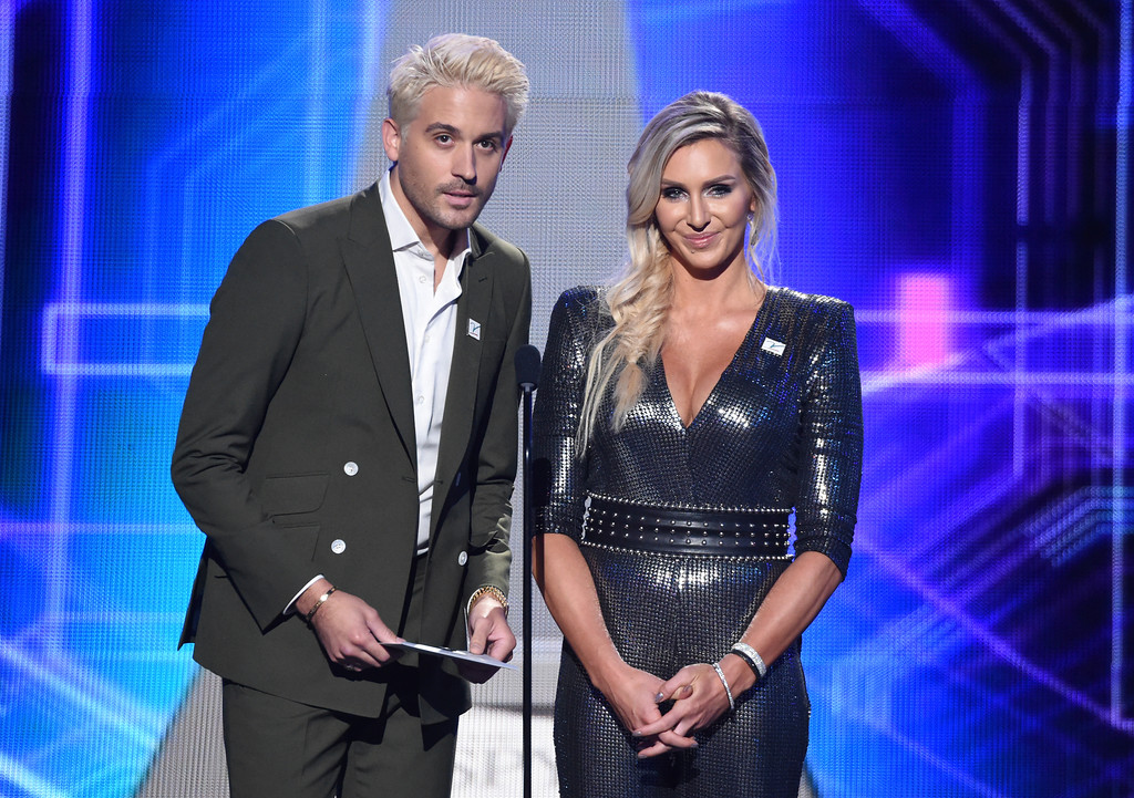 . G-Eazy, left, and Charlotte Flair present the award for best college athlete at the ESPY Awards at Microsoft Theater on Wednesday, July 18, 2018, in Los Angeles. (Photo by Phil McCarten/Invision/AP)