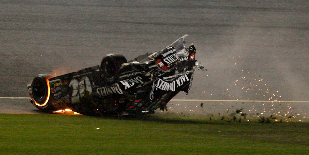 Description of . Clint Bowyer's car slides upside down following a crash on the last lap of the NASCAR Daytona 500 auto race at Daytona International Speedway in Daytona Beach, Fla., Sunday, Feb. 18, 2007. (AP Photo/Glenn Smith)