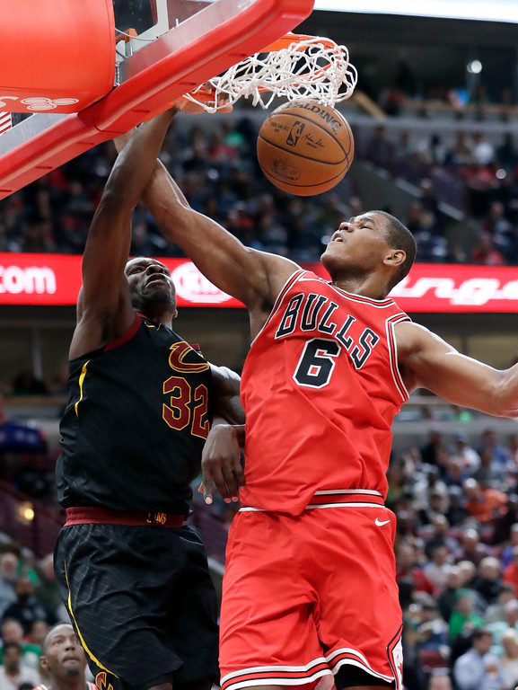 . Cleveland Cavaliers forward Jeff Green, left, scores against Chicago Bulls center Cristiano Felicio during the first half of an NBA basketball game Saturday, March 17, 2018, in Chicago. (AP Photo/Nam Y. Huh)