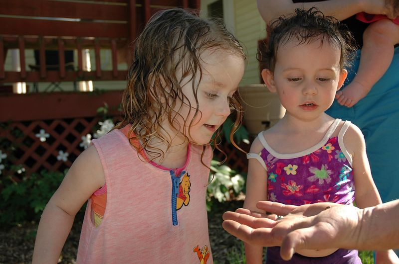 Mary and Tyler check out the roly poly in Trey's hand.