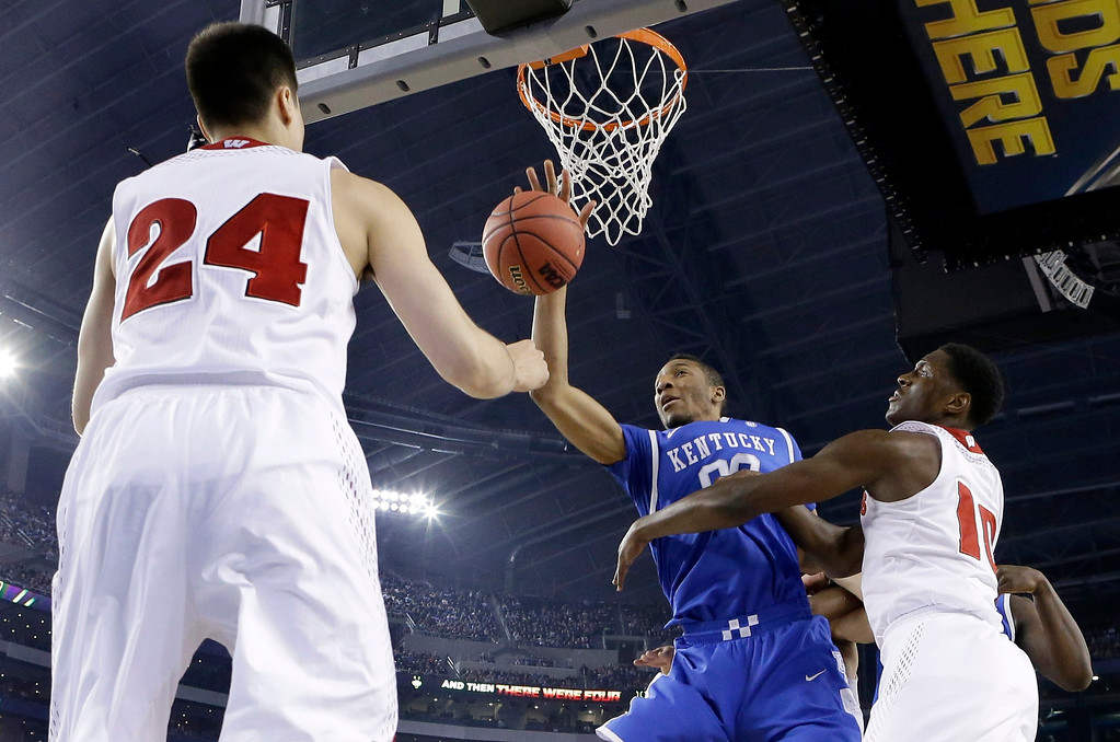 . Wisconsin guard Bronson Koenig (24) and forward Nigel Hayes (10) defend against Kentucky forward Marcus Lee (00) during the first half of the NCAA Final Four tournament college basketball semifinal game Saturday, April 5, 2014, in Arlington, Texas. (AP Photo/Eric Gay)