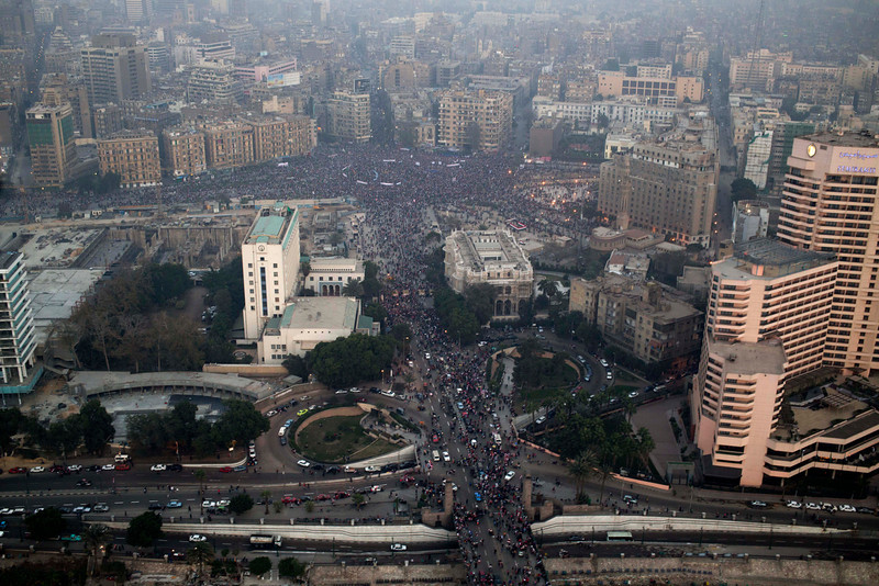 . This aerial image made from an Egyptian army helicopter shows a general view of a pro-military rally marking the third anniversary of the uprising that toppled autocrat Hosni Mubarak in Tahrir Square in Cairo, Egypt, Saturday, Jan. 25, 2014. Egyptian riot police have fired tear gas to disperse hundreds of supporters of ousted Islamist President Mohammed Morsi protesting as the country marks the third anniversary of the 2011 uprising, as supporters of the military gathered in rival rallies in other parts of the capital, many of them urging military chief Gen. Abdel-Fattah el-Sissi, the man who removed Morsi, to run for president.(AP Photo/Hassan Ammar)