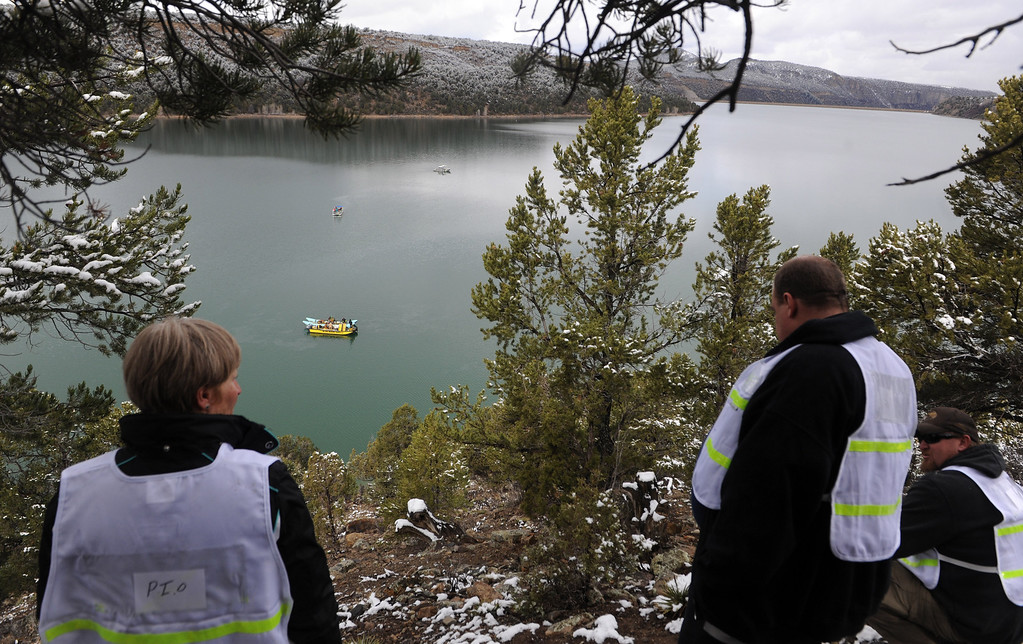 . Officials with Ouray County observe Beegles Aircraft Service Inc. of Greeley Colo conduct salvage operations this morning, Thursday March 27, 2014, at the Ridgway Reservoir near Ridgway, Colo., at the site of a downed aircraft, which crashed last Saturday March 22, 2014 killing five people. (Photo by William Woody/Provided by Ouray County)