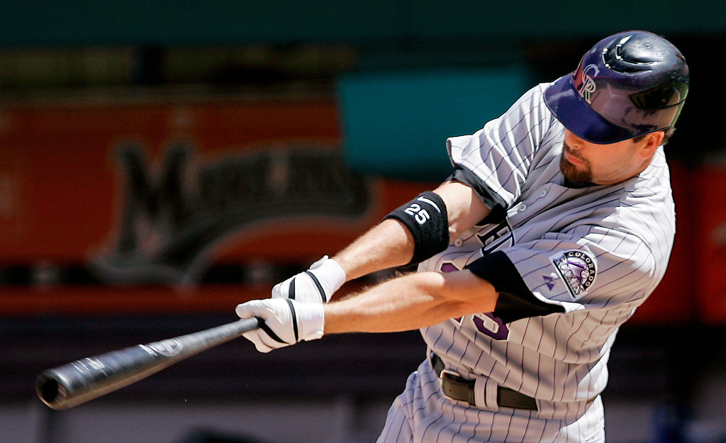 . Colorado Rockies pinch hitter Seth Smith follows through on his base hit against Florida Marlins\' Joe Nelson in the ninth inning of a baseball game in Miami, Sunday, Aug. 3, 2008. Cory Sullivan scored on the base hit. The Rockies won 3-2. (AP Photo/Alan Diaz)