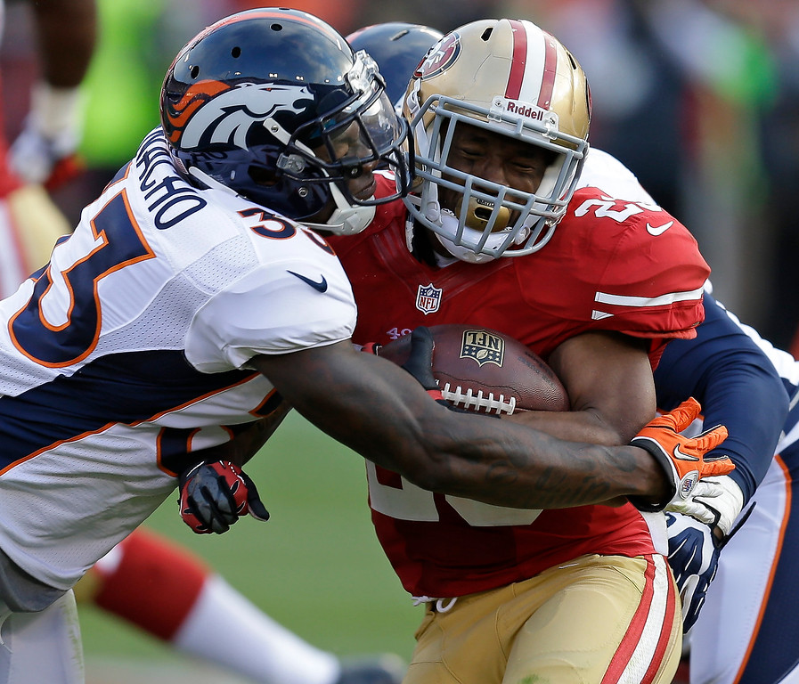 . San Francisco 49ers running back LaMichael James, right, is stopped by Denver Broncos safety Duke Ihenacho, left, during the first quarter of an NFL preseason football game on Thursday, Aug. 8, 2013, in San Francisco. (AP Photo/Ben Margot)