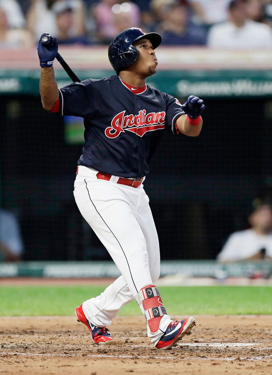 . Cleveland Indians\' Jose Ramirez watches his ball after hitting a sacrifice fly off Minnesota Twins starting pitcher Kyle Gibson in the third inning of a baseball game, Tuesday, Aug. 28, 2018, in Cleveland. Francisco Lindor scored on the play. (AP Photo/Tony Dejak)