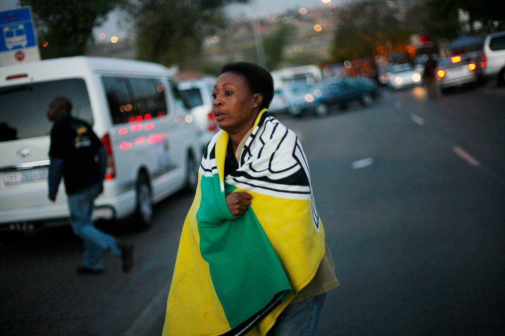 . An ANC Youth League supporter, at a vigil outside former South African President Nelson Mandela\'s house in the Soweto township, on the outskirt of Johannesburg, Thursday June 27, 2013. Nelson Mandela\'s health improved overnight and his condition remains critical but is now stable, the South African government said Thursday in a statement that brought a measure of relief to the country.  (AP Photo/Jerome Delay)