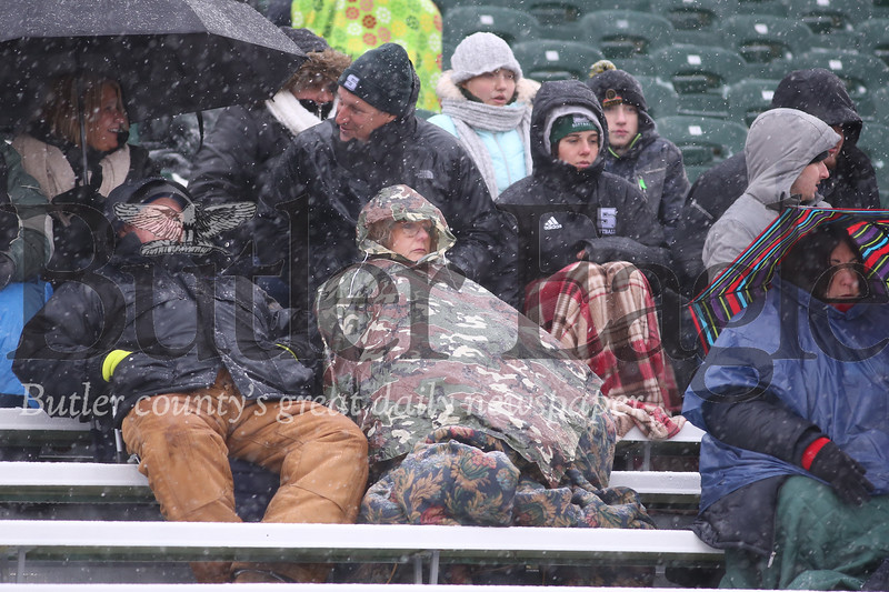 Fans toughed out dropping temperatures and heavy snow to tailgate and watch Slippery Rock University's home playoff game against Minnesota State Saturday. Seb Foltz/Butler Eagle