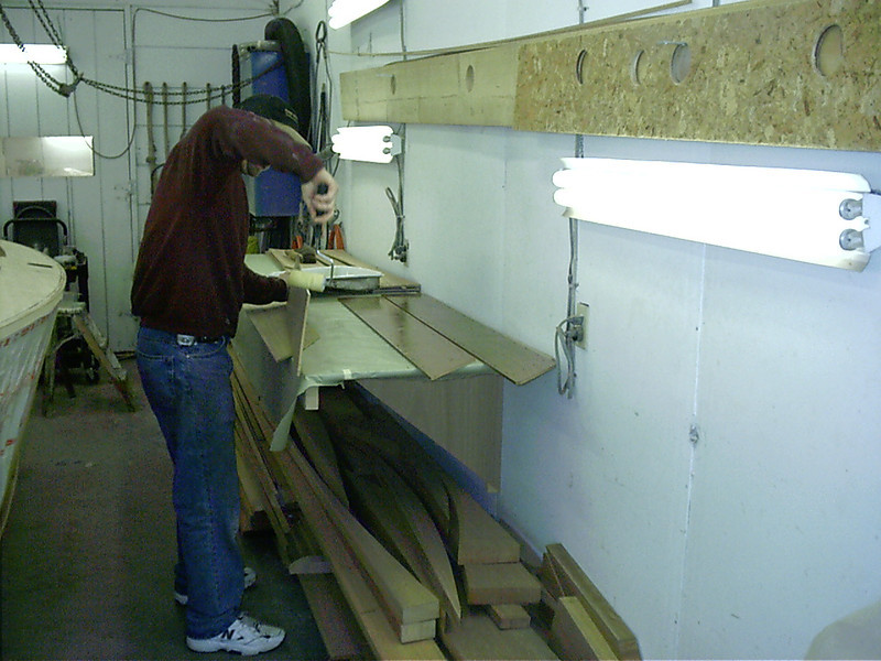 Applying epoxy to deck planks.