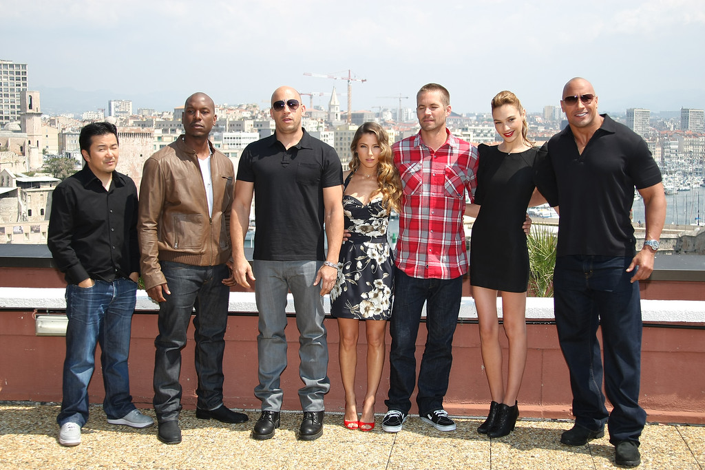 """. Left to right, Justin Lin, Tyrese Gibson, Vin Diesel, Elsa Pataky, Paul Walker, Gal Gadot and Dwayne Johnson pose during a photocall to promote the film \""""Fast and Furious\"""", in Marseille, southern France, Thursday, April 28, 2011. (AP Photo/Claude Paris)"""