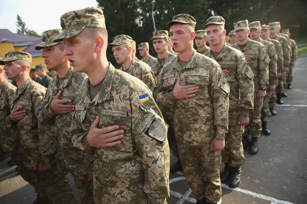 ". Ukrainian soldiers attend the opening ceremony of the ""Rapid Trident\"" NATO military exercises on September 15, 2014 near Yavorov, Ukraine.   (Photo by Sean Gallup/Getty Images)"