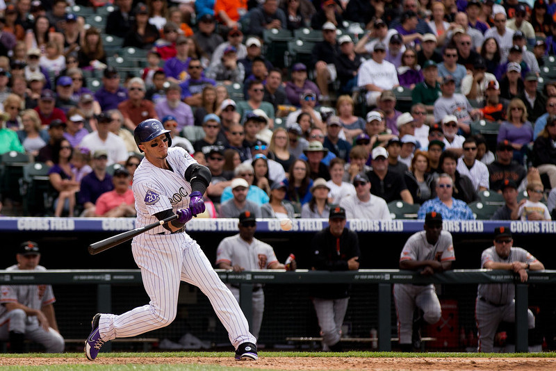 . Troy Tulowitzki #2 of the Colorado Rockies hits a two-RBI single during the sixth inning against the San Francisco Giants at Coors Field on May 19, 2013 in Denver, Colorado.  The Rockies defeated the Giants 5-0.  (Photo by Justin Edmonds/Getty Images)