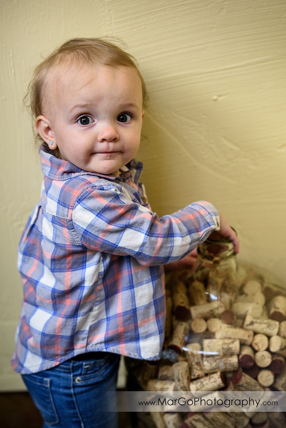baby playing with wine corks, Windmill Ridge Winery