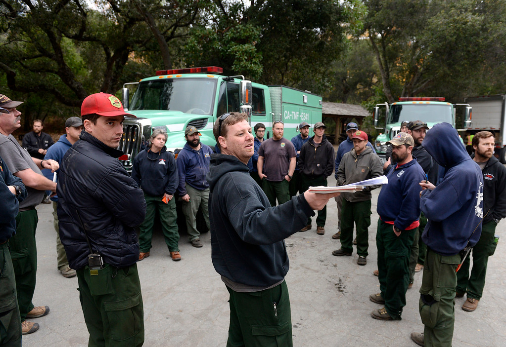 . Firefighters from the the Tahoe National Forest gather at the incident command center after arriving at  in Big Sur, Calif. on Wednesday December 18, 2013. (Photo David Royal/ Monterey County Herald)