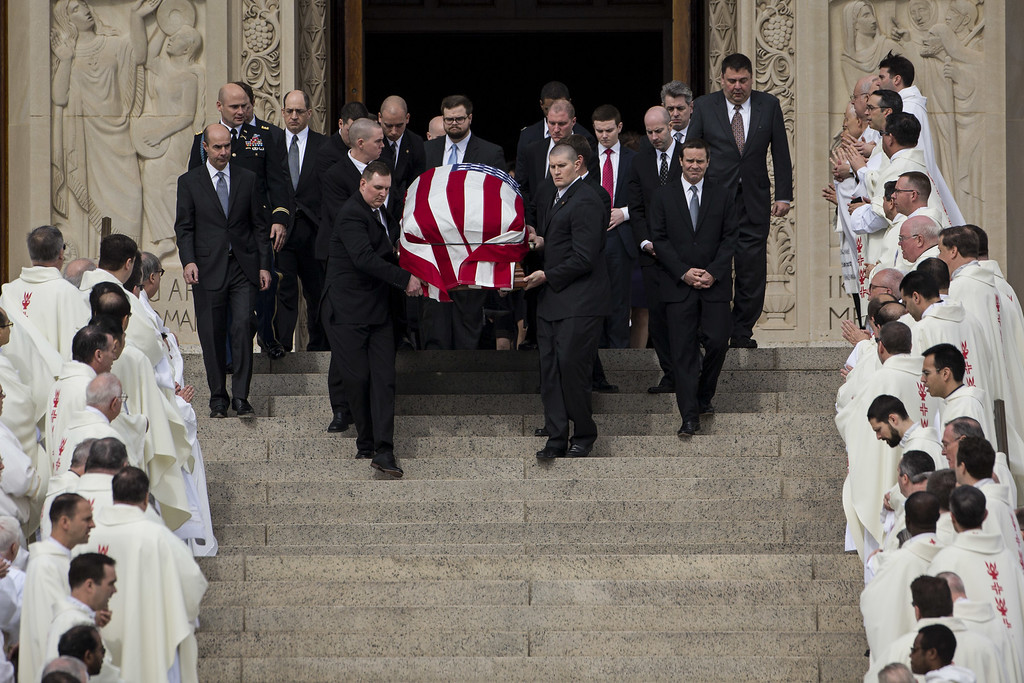 . Followed by family members, pallbearers carry the casket of late Supreme Court justice Antonin Scalia down the steps of the Basilica of the National Shrine of the Immaculate Conception as clergy look on at the end of the funeral, February 20, 2016 in Washington, DC. Scalia, who died February 13 while on a hunting trip in Texas, laid in repose in the Great Hall of the Supreme Court on Friday and his funeral service will be at the basilica today.  (Photo by Drew Angerer/Getty Images)