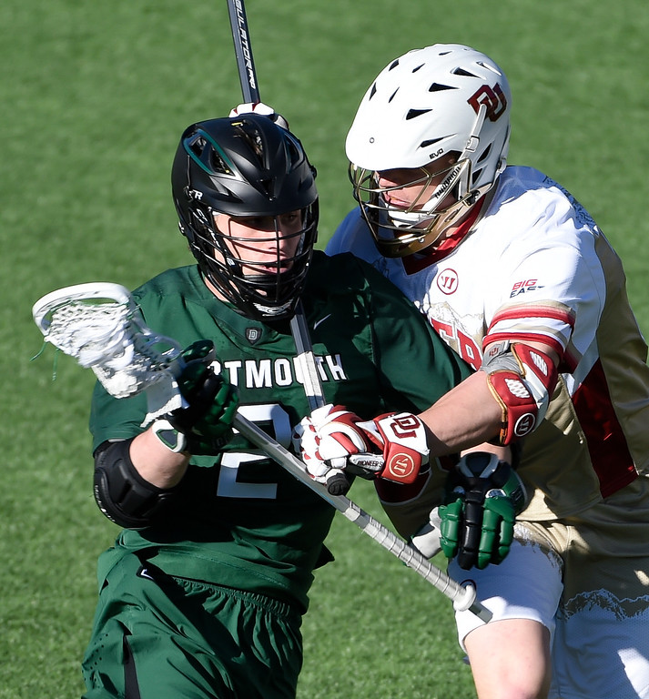 . DENVER, CO - FEBRUARY 28: Denver Max Begoon (36) puts his stick in the side of Dartmouth Jack Korzelius (2) neck in the fourth period during the Face-off Classic February 28, 2016 at Peter Barton Lacrosse Stadium. (Photo By John Leyba/The Denver Post)
