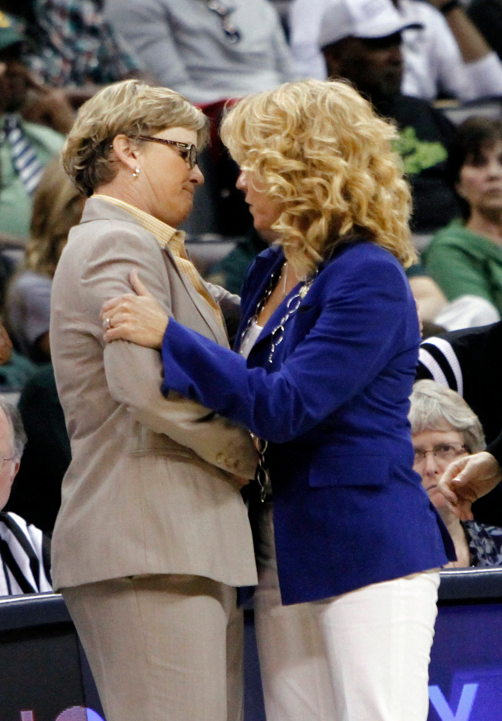 Description of . Tennessee head coach Holly Warlick and Oklahoma head coach Sherri Coale meet after the end of their game in the regional semifinal in the women's NCAA college basketball tournament in Oklahoma City, Sunday, March 31, 2013.  Tennessee won 74-59.  (AP Photo/Alonzo Adams)