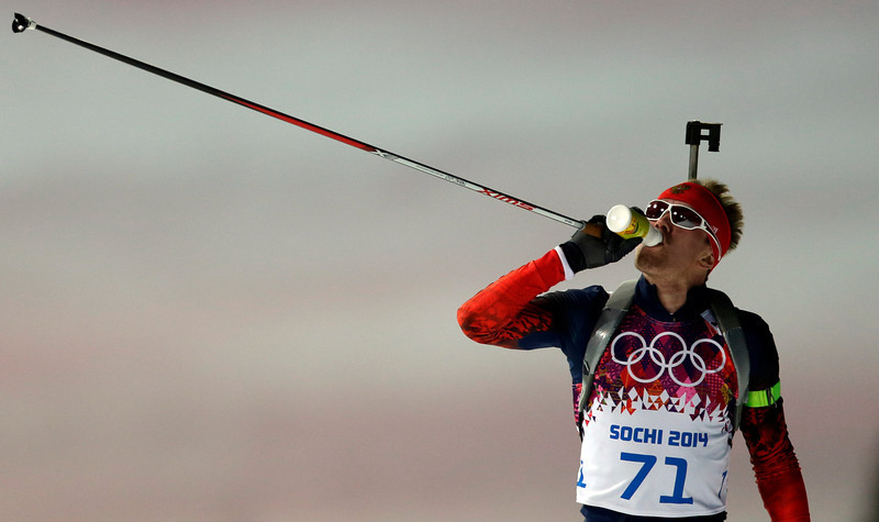 . Russia\'s Alexei Volkov drinks during the men\'s biathlon 20k individual race, at the 2014 Winter Olympics, Thursday, Feb. 13, 2014, in Krasnaya Polyana, Russia. (AP Photo/Felipe Dana)