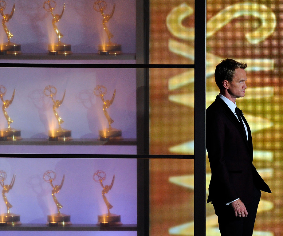 . Host Neil Patrick Harris appears on stage at the 65th Primetime Emmy Awards at Nokia Theatre on Sunday Sept. 22, 2013, in Los Angeles.  (Photo by Chris Pizzello/Invision/AP)