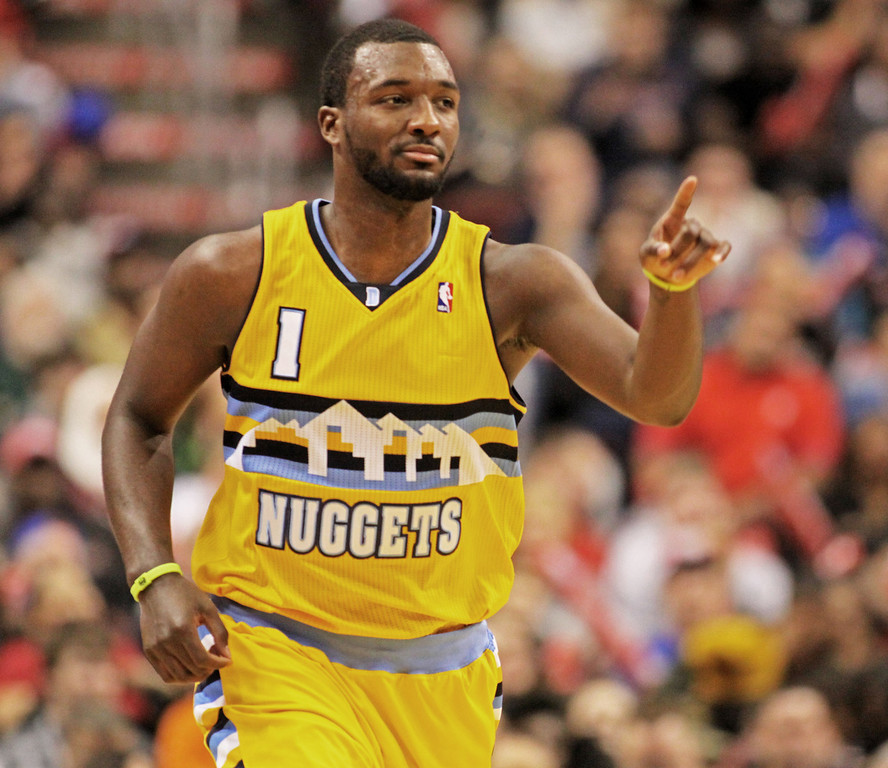 . Denver Nuggets\'  Jordan Hamilton (1) points to his bench after he scored against the Philadelphia 76ers in the second half of an NBA basketball game Saturday Dec. 7, 2013, in Philadelphia.  (AP Photo/H. Rumph Jr)