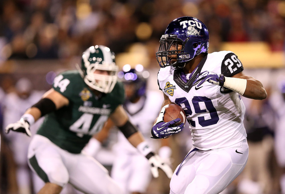 Description of . Running back Matthew Tucker #29 of the TCU Horned Frogs rushes the football against the Michigan State Spartans during first quarter of the Buffalo Wild Wings Bowl at Sun Devil Stadium on December 29, 2012 in Tempe, Arizona.  (Photo by Christian Petersen/Getty Images)