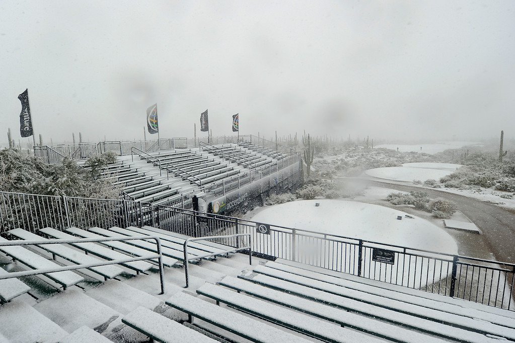 . MARANA, AZ - FEBRUARY 20:  Snow covers the first hole tee and the grandstands as play was suspended during the first round of the World Golf Championships - Accenture Match Play at the Golf Club at Dove Mountain on February 20, 2013 in Marana, Arizona.  (Photo by Stuart Franklin/Getty Images)