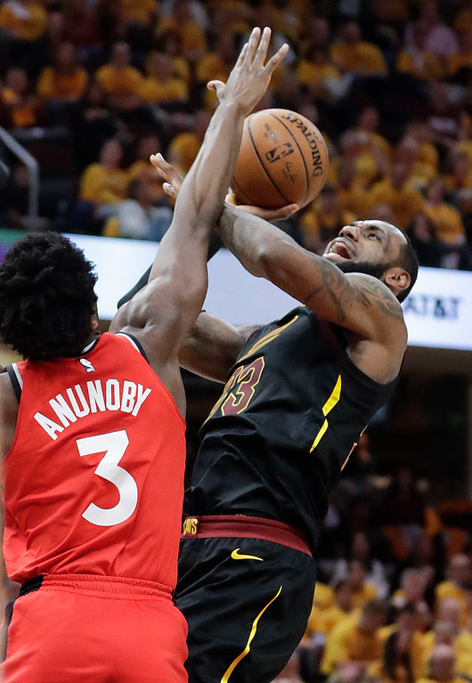 . Cleveland Cavaliers\' LeBron James (23) shoots against Toronto Raptors\' OG Anunoby (3), from England, in the first half of Game 4 of an NBA basketball second-round playoff series, Monday, May 7, 2018, in Cleveland. (AP Photo/Tony Dejak)