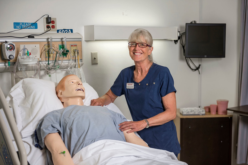 Rural Northern California Simulation Center Director Becky Damazo has providing safe practice to nursing students for the past 11 years. Damazo is photographed with one of the training mannequins in the SimCenter on Tuesday, June 27, 2017 in Chico, Calif. (Jason Halley/University Photographer)