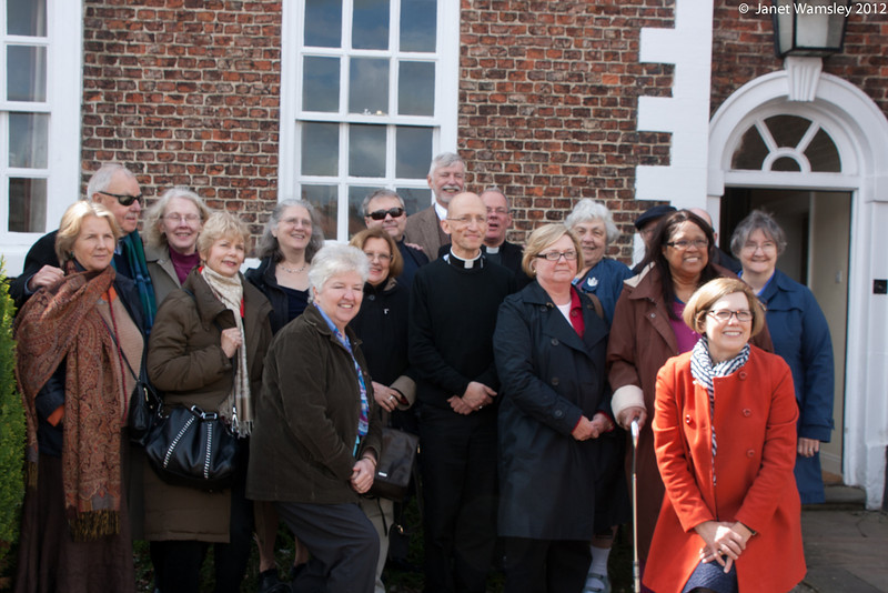 Group shot in front of the bishop's house