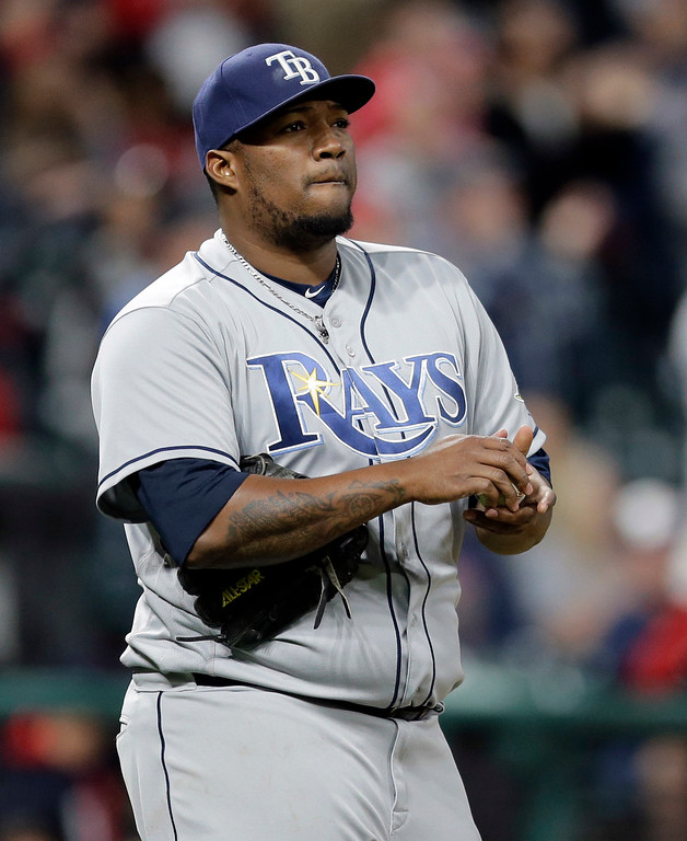 . Tampa Bay Rays relief pitcher Jumbo Diaz waits for Cleveland Indians\' Francisco Lindor to run the bases after Lindor hit a solo home run in the eighth inning of a baseball game, Monday, May 15, 2017, in Cleveland. The Indians won 8-7. (AP Photo/Tony Dejak)