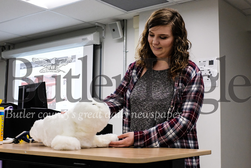 Cara Buccini, a Slippery Rock University senior studying animal-assisted interventions, interacts with a new therapeutic robot made to look like a baby harp seal that is used as an alternative to live animals.