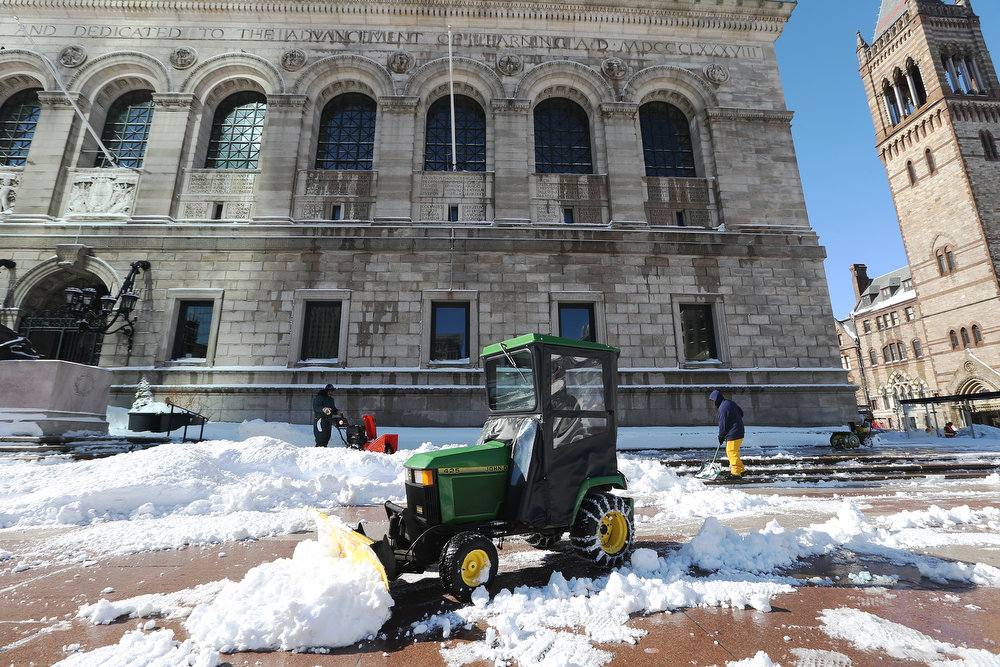 . Snow is cleared in front of the Boston Public Library following a powerful blizzard on February 10, 2013 in Boston, Massachusetts. The storm dumped more than two feet of snow in parts of New England and more than 200,000 Massachusetts customers remain without power.  (Photo by Mario Tama/Getty Images)