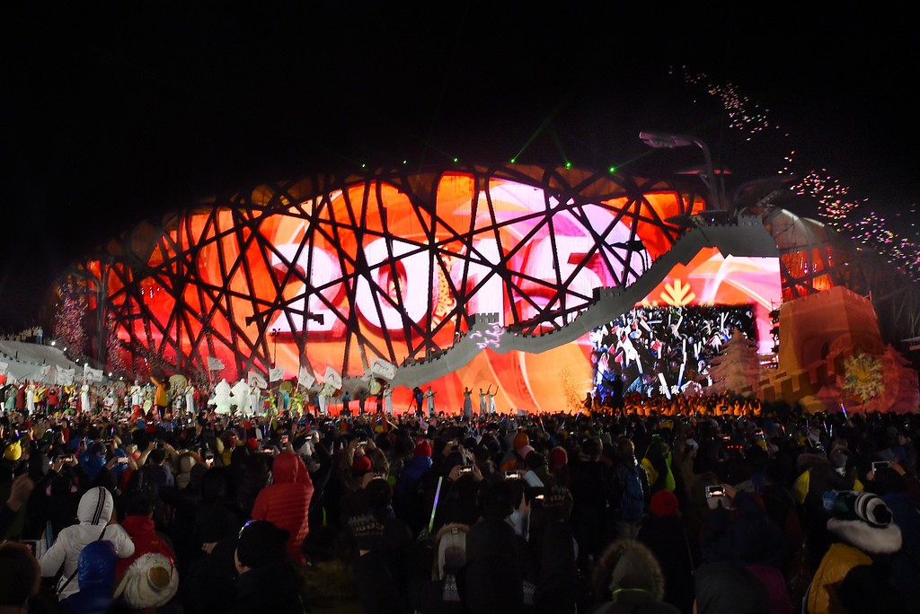 . People cheer during the New Year\'s Eve countdown event in front of Beijing\'s National Stadium, Known as the Bird\'s Nest in Beijing on January 1, 2015. Beijing is bidding to host the 2022 Winter Olympic Games, with a decision on the winning city to be made in July 2015.        AFP PHOTO / WANG ZHAOWANG ZHAO/AFP/Getty Images