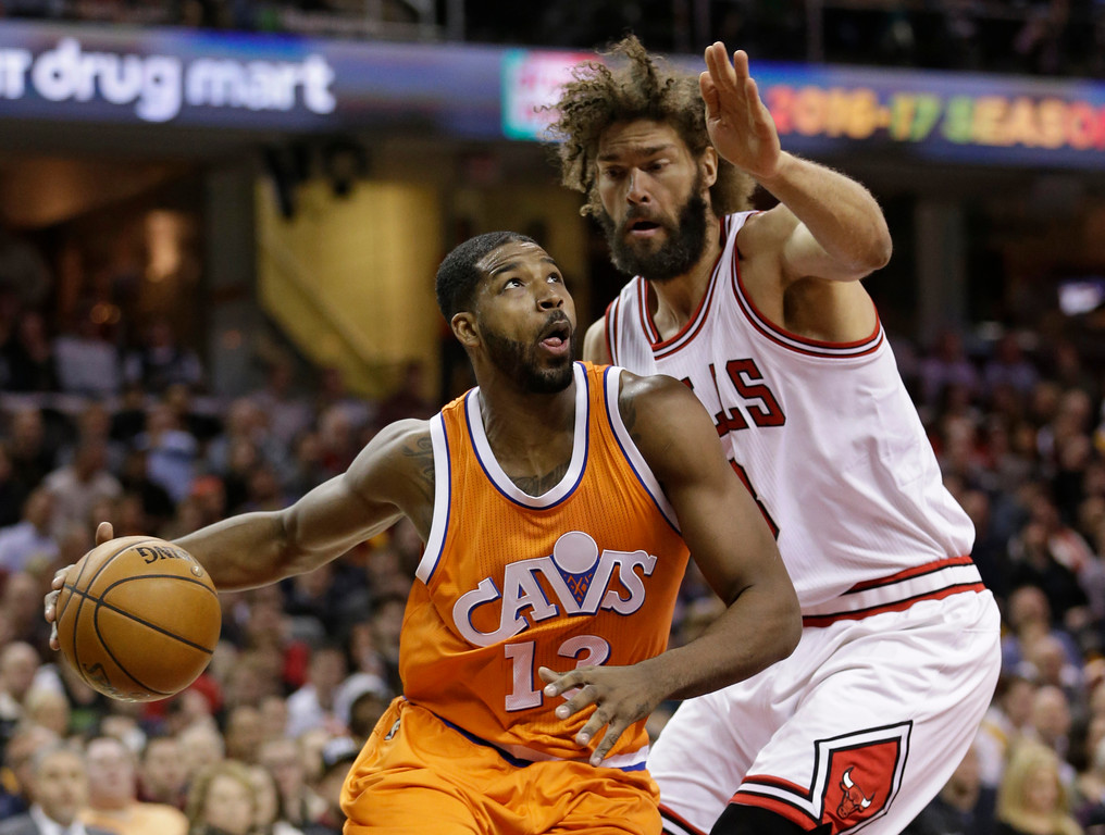 . Cleveland Cavaliers\' Tristan Thompson, left, drives against Chicago Bulls\' Robin Lopez in the first half of an NBA basketball game, Wednesday, Jan. 4, 2017, in Cleveland. (AP Photo/Tony Dejak)
