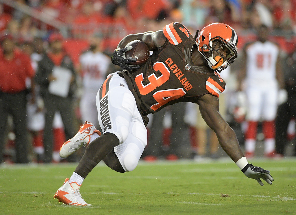 . Cleveland Browns running back Isaiah Crowell (34) runs against the Tampa Bay Buccaneers during the first quarter of an NFL preseason football game Saturday, Aug. 26, 2017, in Tampa, Fla. (AP Photo/Phelan Ebenhack)